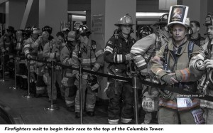 Firefighters wait to begin their race to the top of the Columbia Tower.