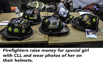 Firefighters raise money for special girl with CLL and wear photos of her on their helmets.