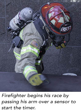 Firefighter starts his timer and the race begins!
